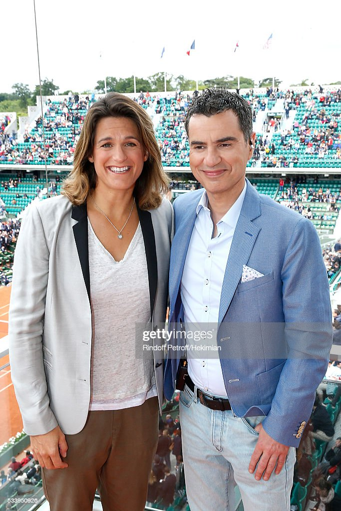 Sports journalist Laurent Luyat (R) poses with his Co-Presenter <a gi-track='captionPersonalityLinkClicked' href=/galleries/search?phrase=Amelie+Mauresmo&family=editorial&specificpeople=161389 ng-click='$event.stopPropagation()'>Amelie Mauresmo</a> (L) at France Television french chanel studio during the 2016 French Tennis Open - Day Three at Roland Garros on May 24, 2016 in Paris, France.