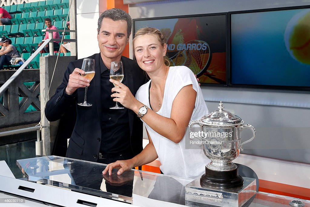 Sports journalist Laurent Luyat poses with Tennis player <a gi-track='captionPersonalityLinkClicked' href=/galleries/search?phrase=Maria+Sharapova&family=editorial&specificpeople=157600 ng-click='$event.stopPropagation()'>Maria Sharapova</a> at France Television french chanels studio after she won the Roland Garros French Tennis Open 2014 - Day 14 on June 7, 2014 in Paris, France.