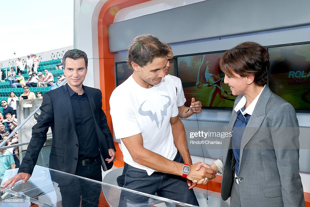 Sports journalist Laurent Luyat, tennis player Rafael Nadal and Minister of Women's Rights, the City and the Youth and Sports Najat Vallaud-Belkacem pose at France Television french chanels studio after she won the Roland Garros French Tennis Open 2014 - Day 14 on June 7, 2014 in Paris, France.