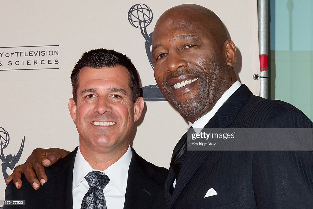 Sports journalists Chris McGee (L) and <a gi-track='captionPersonalityLinkClicked' href=/galleries/search?phrase=James+Worthy&family=editorial&specificpeople=212863 ng-click='$event.stopPropagation()'>James Worthy</a> arrives at the Academy of Television Arts & Sciences 65th Los Angeles Area Emmy Awards at Leonard H. Goldenson Theatre on August 3, 2013 in North Hollywood, California.
