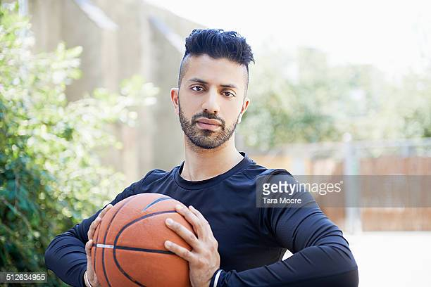 sports man holding basketball