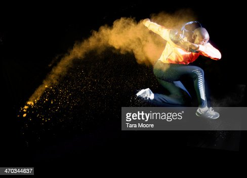 sports man umping with orange smoke