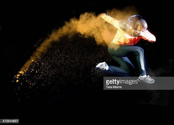 sports man umping with orange smoke