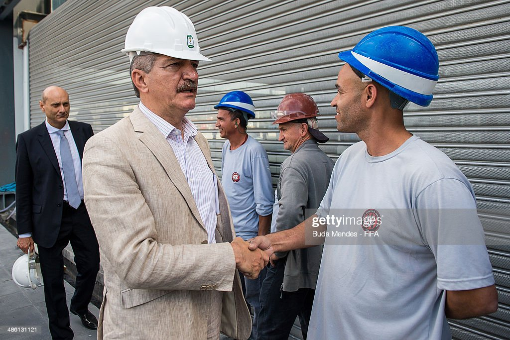 Sports Minister <a gi-track='captionPersonalityLinkClicked' href=/galleries/search?phrase=Aldo+Rebelo&family=editorial&specificpeople=772117 ng-click='$event.stopPropagation()'>Aldo Rebelo</a> greets construction workers during the 2014 FIFA World Cup Host City Tour on April 22, 2014 in Curitiba, Brazil