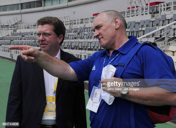 Sports Minister Gerry Sutcliffe with Dave Collins the UK Athletics Performance Director watch GB athletes train in Macau today as they complete their...