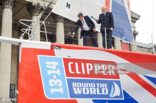 Sports Minister Hugh Robertson and Sir Robin KnoxJohnston christen the yacht 'Great Britain' at a launch event in Trafalgar Square London