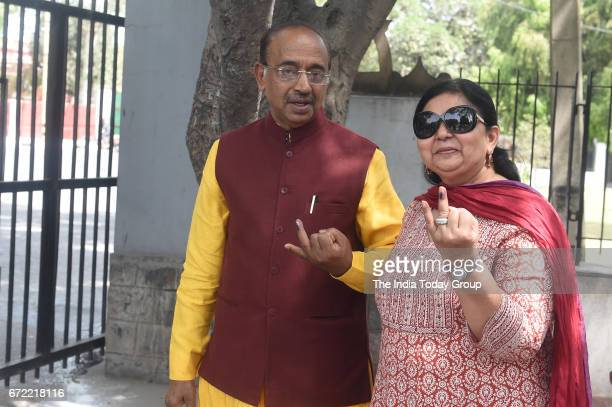 Sports Minister Vijay Goel along with his wife at a polling booth after casting his vote for MCD Election 2017 in New Delhi