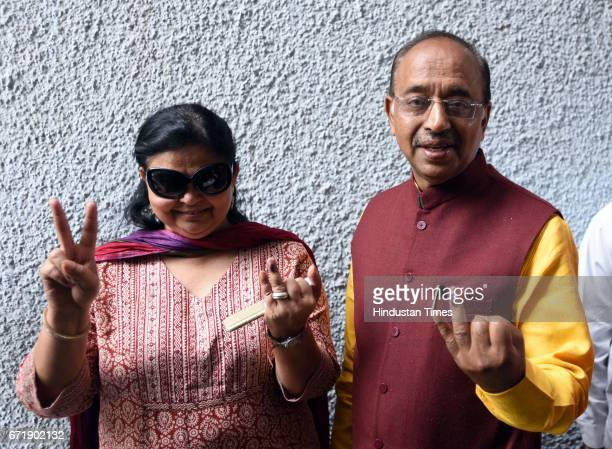 Sports Minister Vijay Goel showing his inkmarked finger with his wife after casting his vote for Delhi MCD elections at St Xaviers School on April 23...