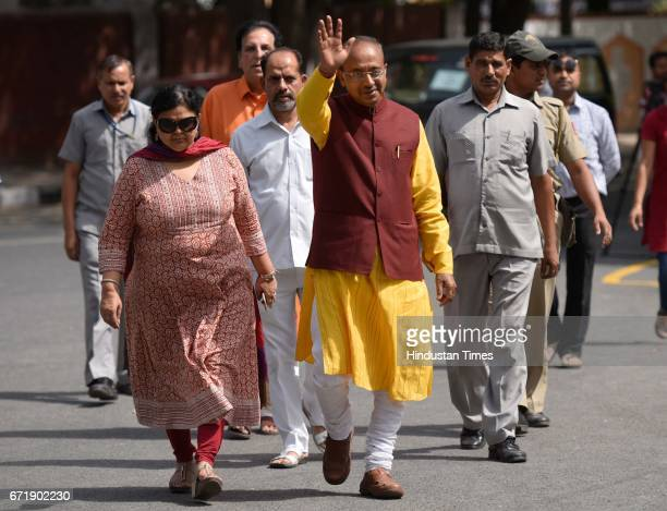 Sports Minister Vijay Goel with his wife comes to cast his vote for Delhi MCD Elections at St Xaviers School on April 23 2017 in New Delhi India...