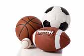 A variety of sports balls including a football, basketball, baseball and a soccer or European football