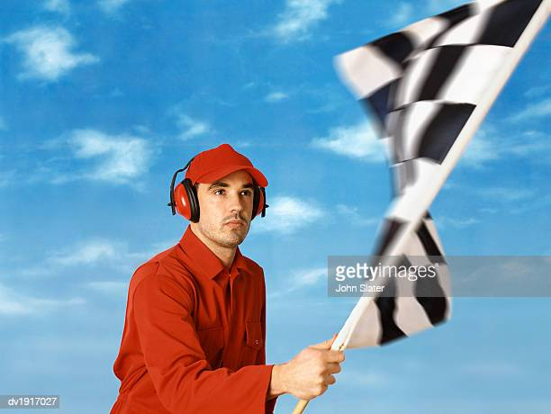 Sports Official Waving a Checkered Flag