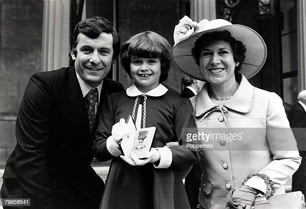 9th March 1976 Fulham and former England footballer Alan Mullery pictured with his wife June and daughter Samantha after he had received an MBE from...