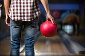 Man's hand with ball in bowling