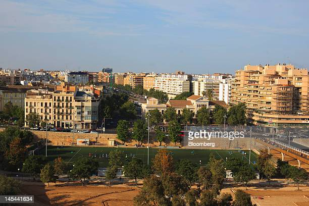 A sports pitch and residential buildings are seen on the city skyline in Valencia Spain on Tuesday May 29 2012 The collapse of regional finances is...