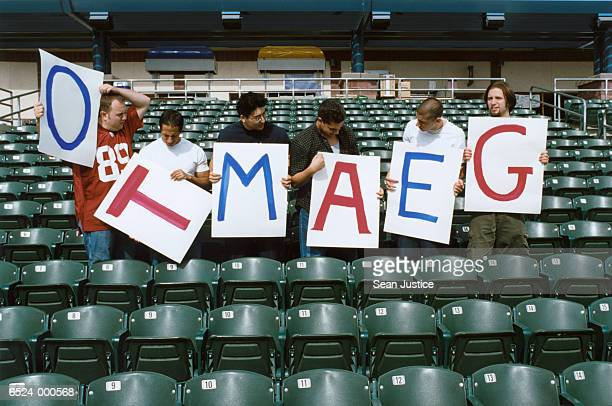 Sports Spectators with Sign