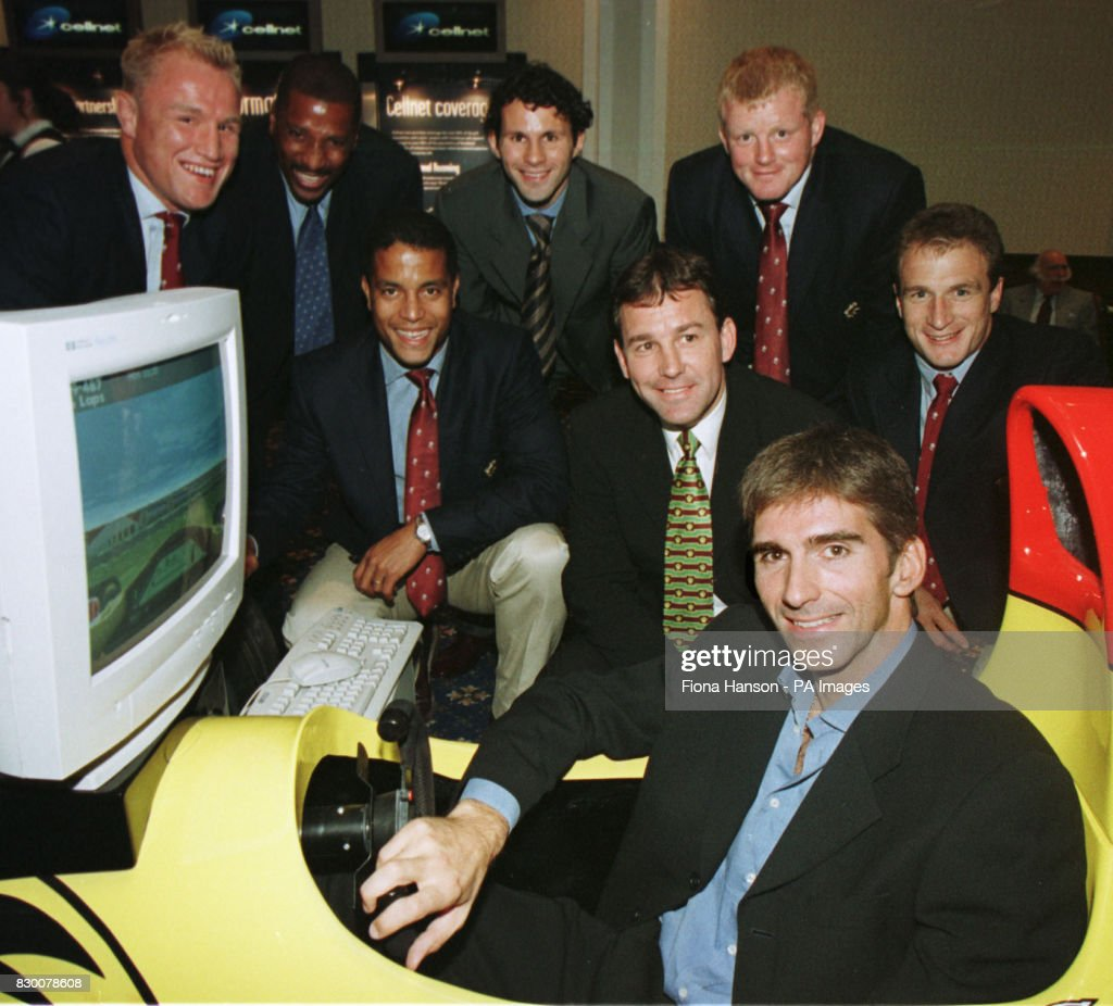 Sports stars from the race driving, rugby and football worlds gathered at a reception hosted by Cellnet during the Labour Party Conference in Blackpool this evening (Thursday). Damon Hill, front in the F1 simulator, is surrounded left to right by Neil Back, Viv Anderson , Jeremy Guscott , Ryan Giggs, Bryan Robson, Dorian West and Mike Catt. Photograph by Fiona Hanson/PA