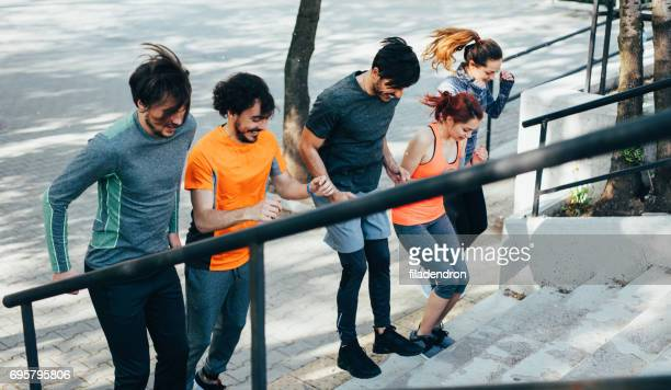 Sports team exercising on a staircase