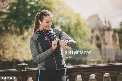 Sports woman checking her tech watch