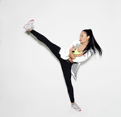 sports woman doing karate kick
