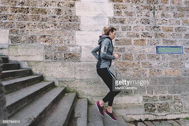 Sports woman jogging on the stairs