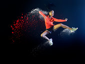 sports woman jumping with coloured powder