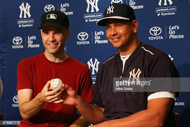 Sports writer and baseball collector Zack Hample poses for a photo with Alex Rodriguez of the New York Yankees after giving Rodriguez the ball from...
