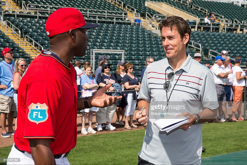 Sports writer Tom Verducci talks with former outfielder Torii Hunter #48 of the Minnesota Twins against the Baltimore Orioles during a spring training game on March 5, 2016 at Hammond Stadium in Fort Myers, Florida.