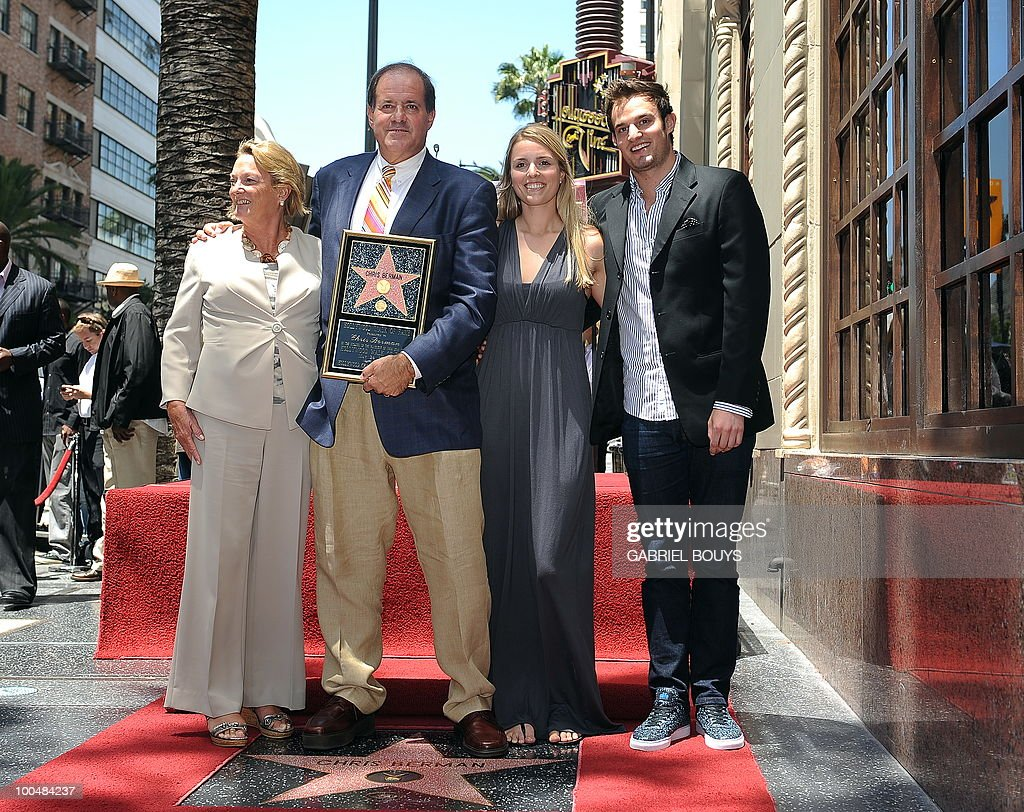 ESPN sportscaster Chris Berman poses with his family after being honored by a Star on the Hollywood Walk of Fame, on May 24, 2010 in Hollywood, California.