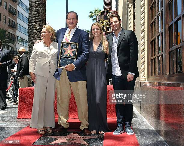 ESPN sportscaster Chris Berman poses with his family after being honored by a Star on the Hollywood Walk of Fame on May 24 2010 in Hollywood...