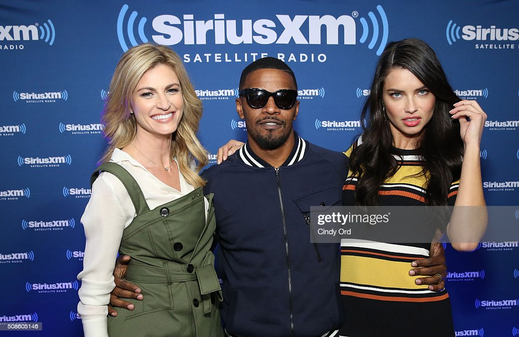 Sportscaster Erin Andrews actor Jamiie Foxx and model Adriana Lima visit the SiriusXM set at Super Bowl 50 Radio Row at the Moscone Center on...