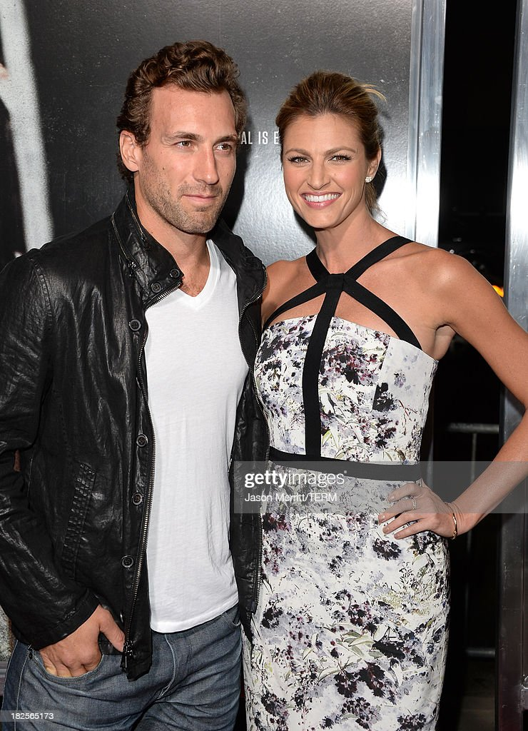 Sportscaster Erin Andrews (R) and guest attend the premiere of Columbia Pictures' 'Captain Phillips' at the Academy of Motion Picture Arts and Sciences on September 30, 2013 in Beverly Hills, California.