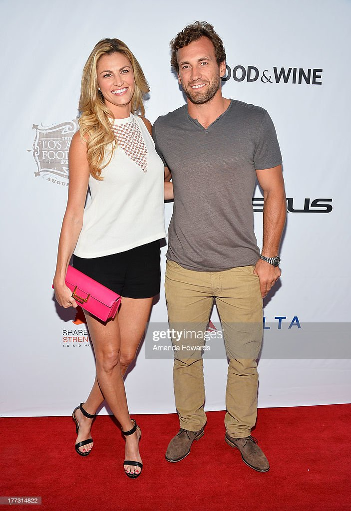 Sportscaster Erin Andrews (L) and her boyfriend, NHL player Jarret Stoll arrive at the opening night of the 2013 Los Angeles Food & Wine Festival - 'Festa Italiana With Giada De Laurentiis' on August 22, 2013 in Los Angeles, California.