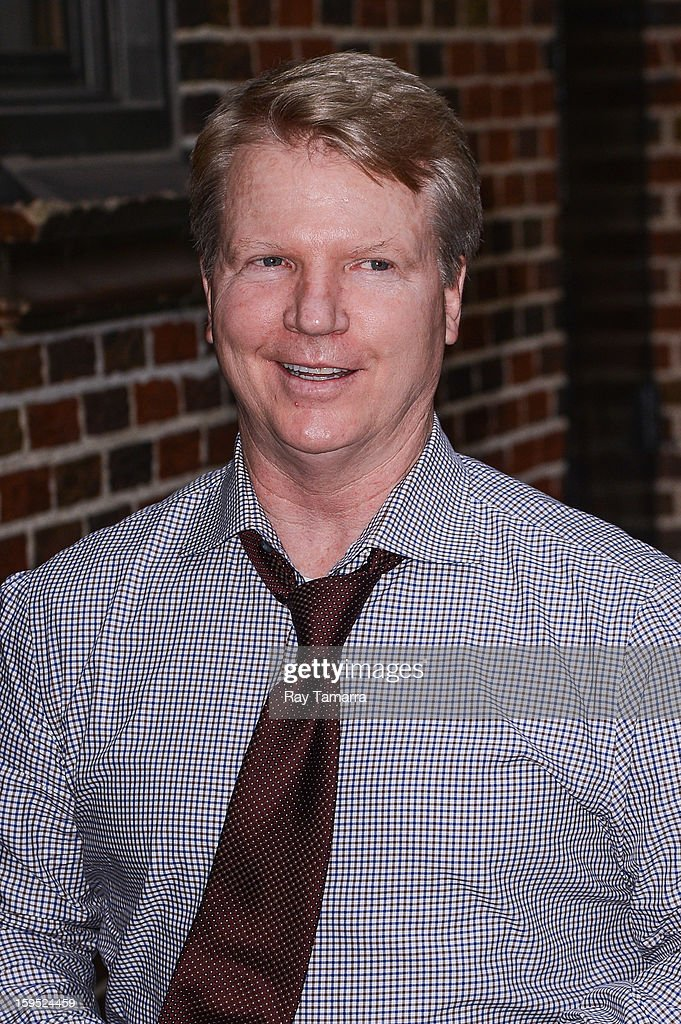 TV sportscaster <a gi-track='captionPersonalityLinkClicked' href=/galleries/search?phrase=Phil+Simms&family=editorial&specificpeople=544734 ng-click='$event.stopPropagation()'>Phil Simms</a> enters the 'Late Show With David Letterman' taping at the Ed Sullivan Theater on January 14, 2013 in New York City.