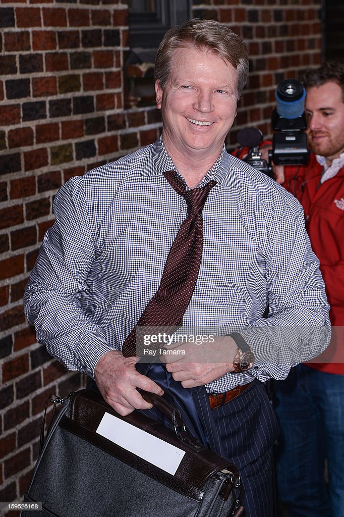 TV sportscaster Phil Simms enters the 'Late Show With David Letterman' taping at the Ed Sullivan Theater on January 14, 2013 in New York City.