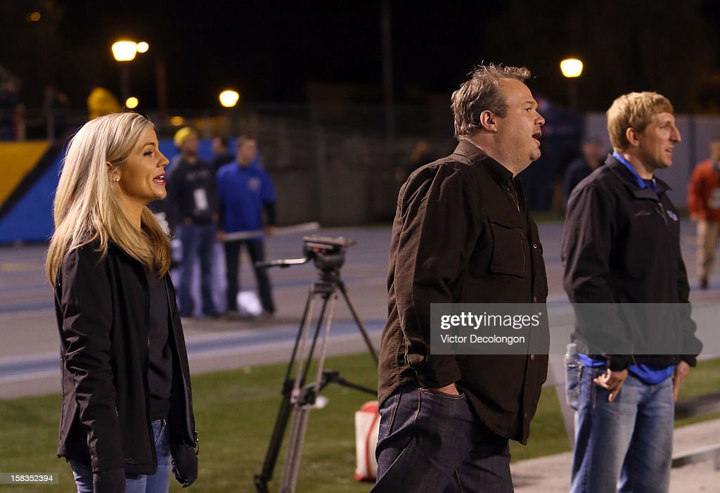Sportscaster Samantha Steele and actor Eric Stonestreet watch the Got Your 6 And Pat Tillman Foundation benefit game from the sideline on December 13, 2012 in Norwalk, California.