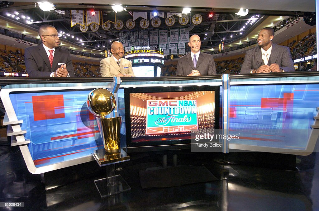 Sportscaster Stuart Scott sportswriter Michael Wilbon analyst Jon Barry of ESPN and Dwyane Wade of the Miami Heat talk on the set of the GMC NBA...