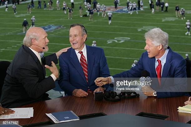 FOX Sportscaster Terry Bradshaw speaks with former US Presidents George Bush and Bill Clinton in the FOX Broadcast booth during the XXXIX Superbowl...