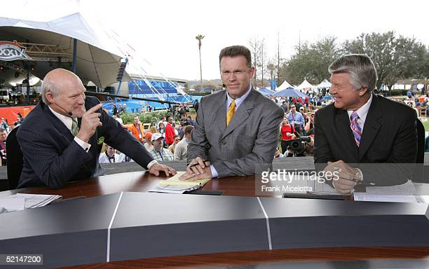 FOX sportscasters Terry Bradshaw Howie Long and Jimmy Johnson speak in the FOX Braodcast booth during the XXXIX Superbowl pregame show at Alltel...