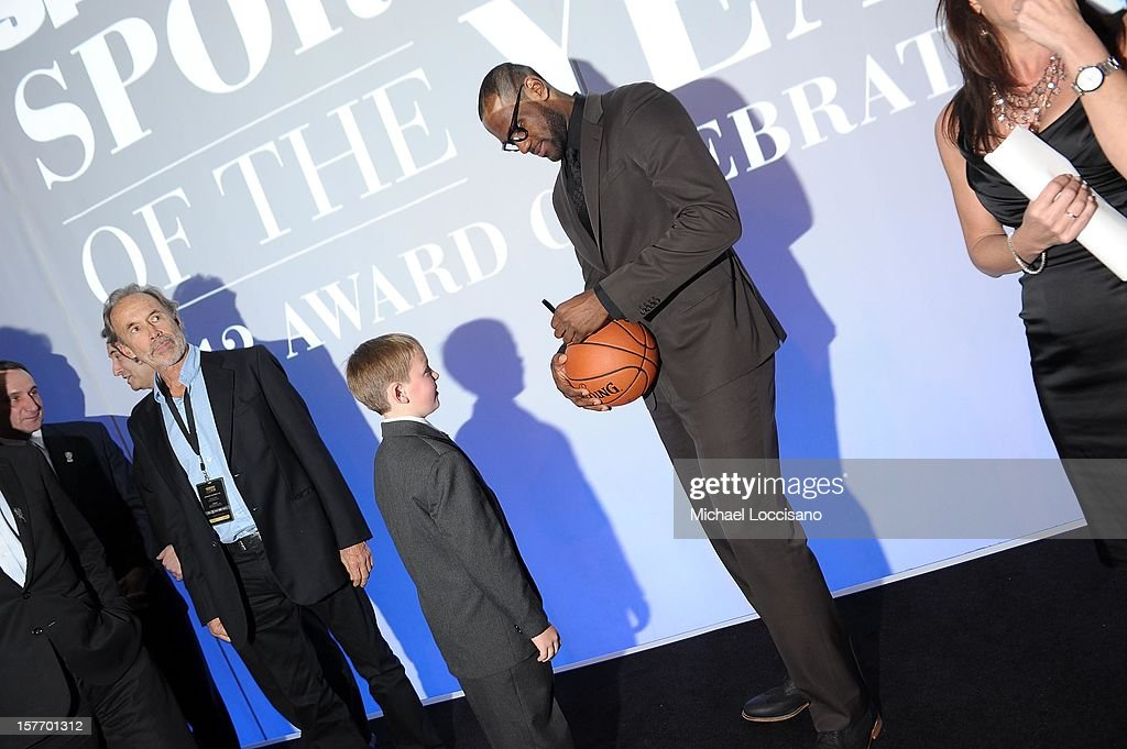 Sportskid Conner Long and 2012 Sportsman of the Year <a gi-track='captionPersonalityLinkClicked' href=/galleries/search?phrase=LeBron+James&family=editorial&specificpeople=201474 ng-click='$event.stopPropagation()'>LeBron James</a> attend the 2012 Sports Illustrated Sportsman of the Year award presentation at Espace on December 5, 2012 in New York City.