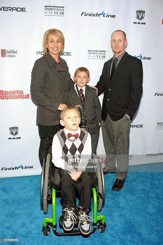 Sportskid Conner Long (C), Jenny Long, Jeff Long and Cayden Long attend the 2012 Sports Illustrated Sportsman of the Year award presentation at Espace on December 5, 2012 in New York City.