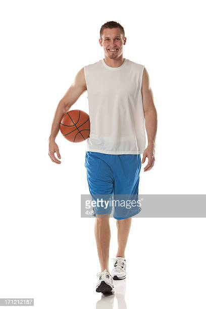 Sportsman carrying a basketball