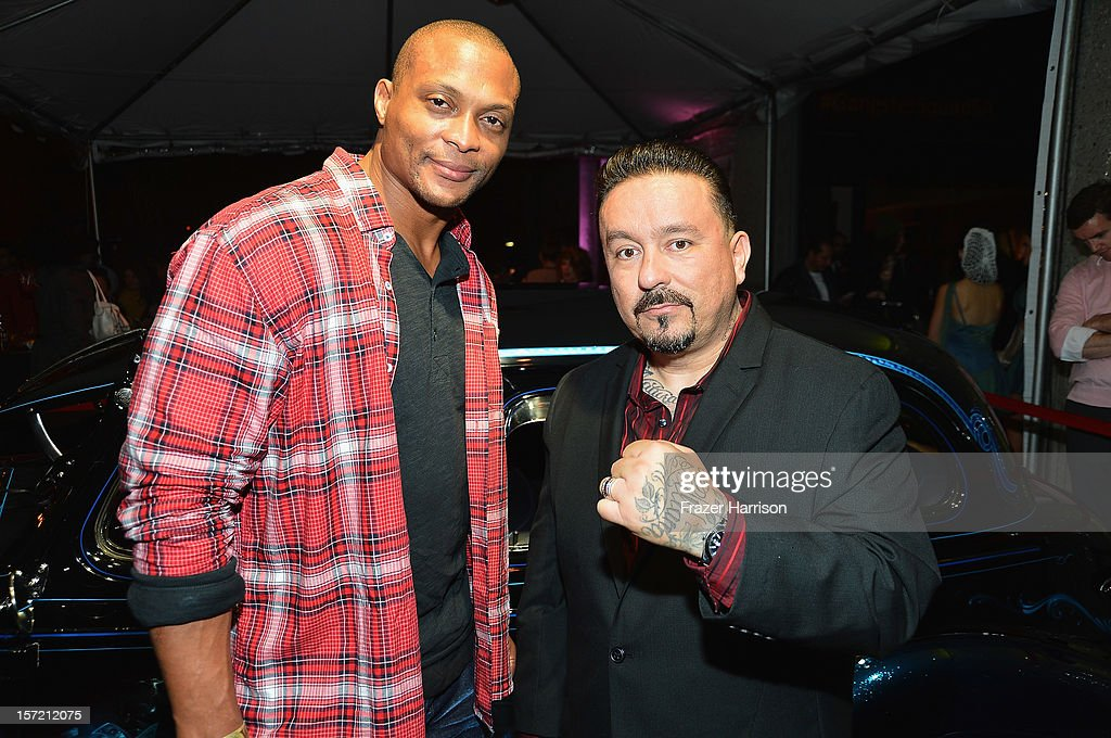 Sportsman Eddie George and artist Mister Cartoon attend SA Studios and Mister Cartoon VIP Screening and After Party of Warner Brothers Pictures 'Gangster Squad' at SA Studios on November 29, 2012 in Los Angeles, California.