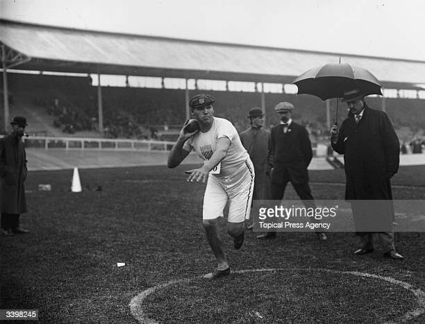 US sportsman Ralph Rose prepares for the first of the shot puts which won him first place at the 1908 Olympic Games at the White City Stadium London