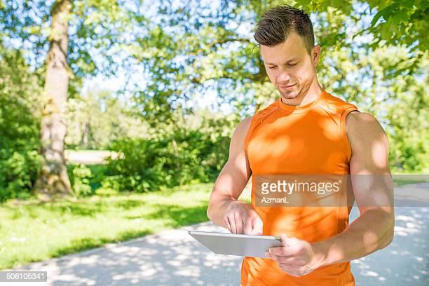 Sportsman using digital tablet