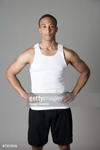 Sportsman with hands on hips