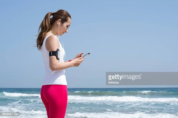 Sportsman you are listening to music at the beach