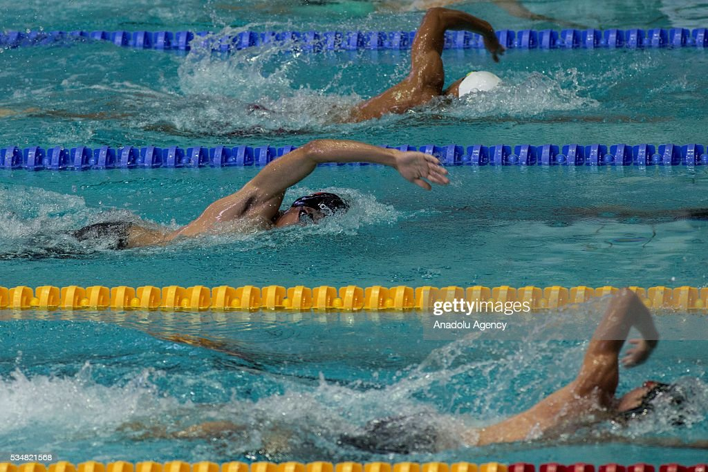 Sportsmen compete during the swimming of the men's final World Championship in modern pentathlon at Olympic Sports Complex in Moscow, Russia, on May 28, 2016.