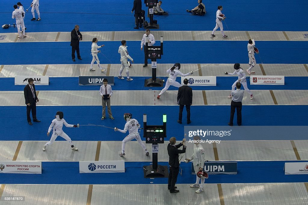 Sportsmen compete in the fencing at the mixed relay World Championship in modern pentathlon in Olympic Sports Complex in Moscow, Russia, on May 29, 2016.