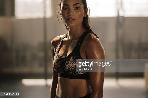 Sportswoman after intense crossing training session : Stock Photo