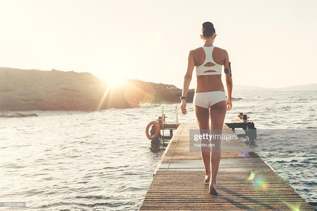 Sportswoman at the quay : Stock Photo